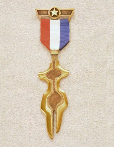 piece meda: female figure, 1974, brass, fabric