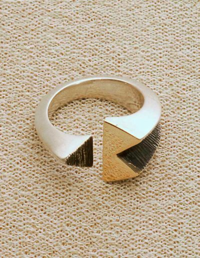 ring: silver, gold accents